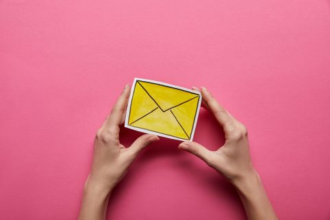 Yellow envelope on pink background to represent email marketing.